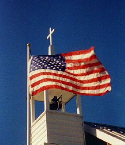 steeple with Cross and USA flag